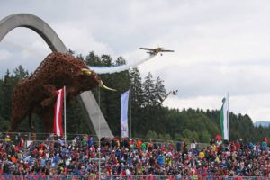 Hannes Arch (AUT) air display, passing over the grandstand and Red Bull iron sculpture.