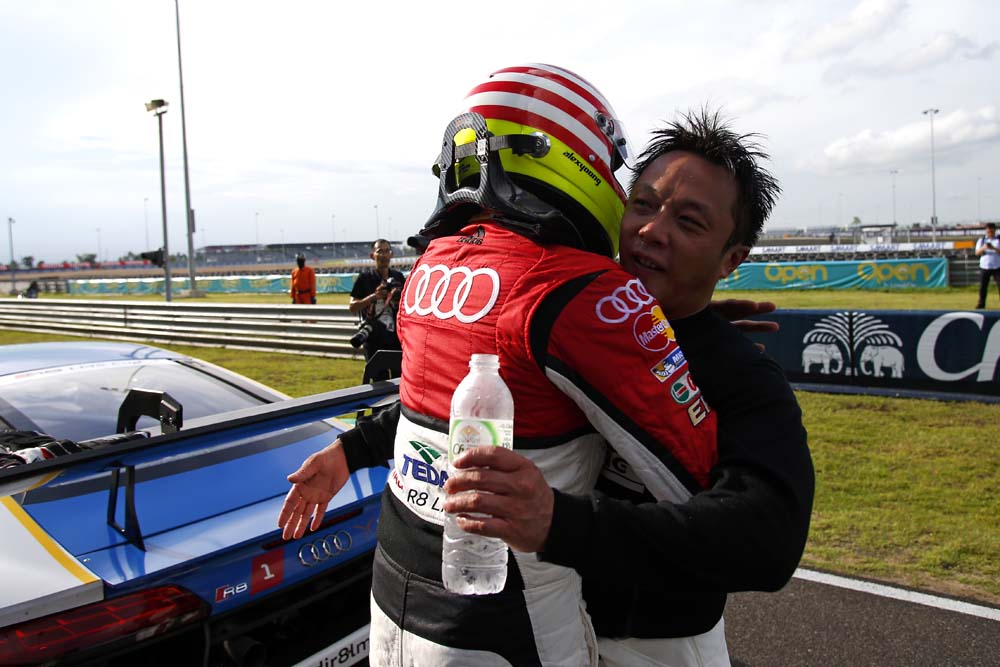 Alex Yoong (MAL) Audi TEDA Racing Team and Marchy Lee (HKG) Audi Hong Kong celebrate in parc ferme at Audi R8 LMS Cup, Rd3 and Rd4, Buriram International, Circuit, Buriram, Thailand, 22-24 July 2016.