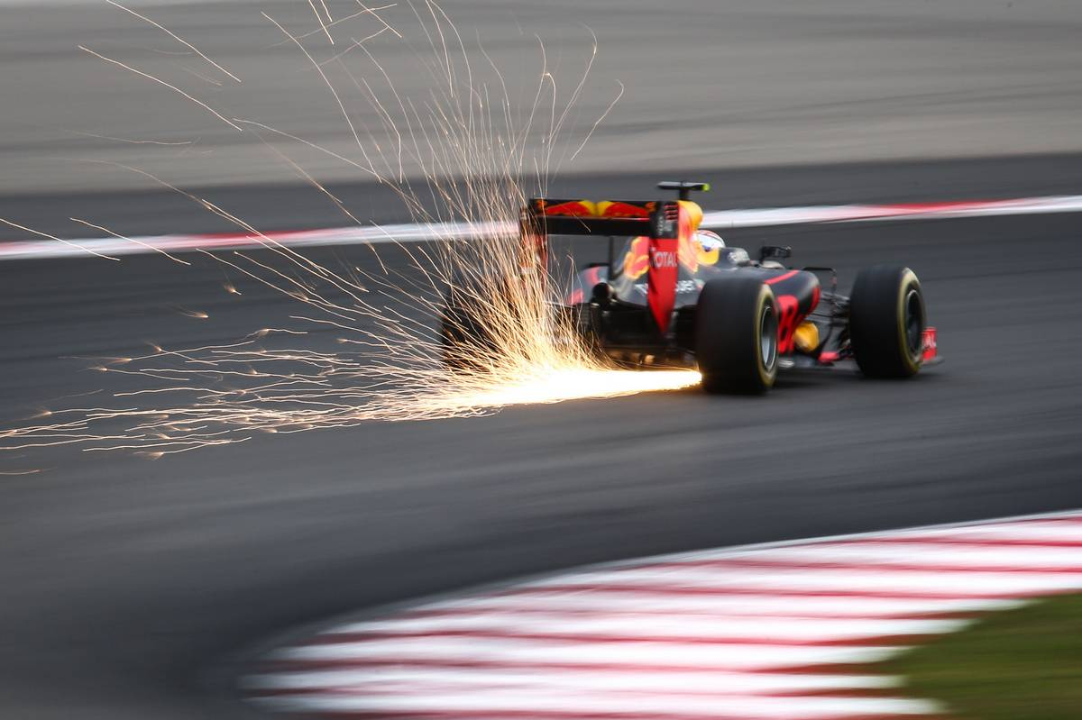 Max Verstappen (NLD) Red Bull Racing RB12 sends sparks flying.