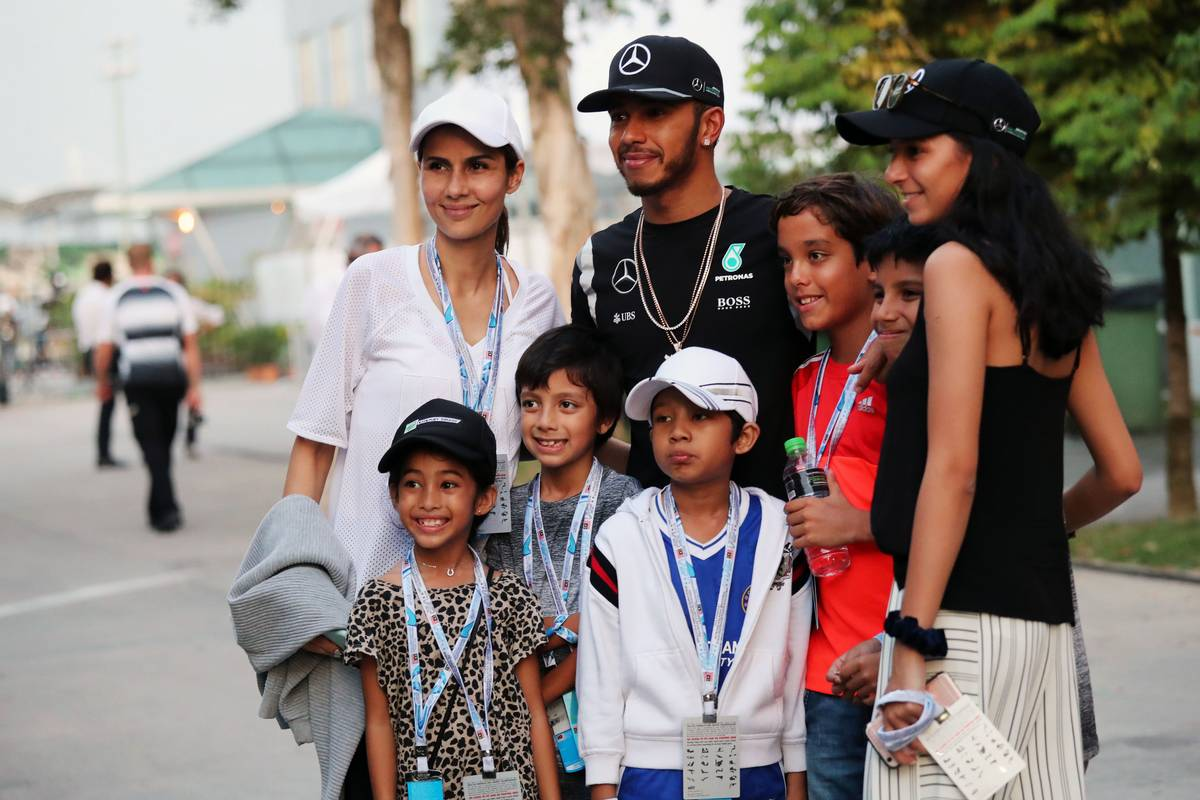 Lewis Hamilton (GBR) Mercedes AMG F1 with fans.