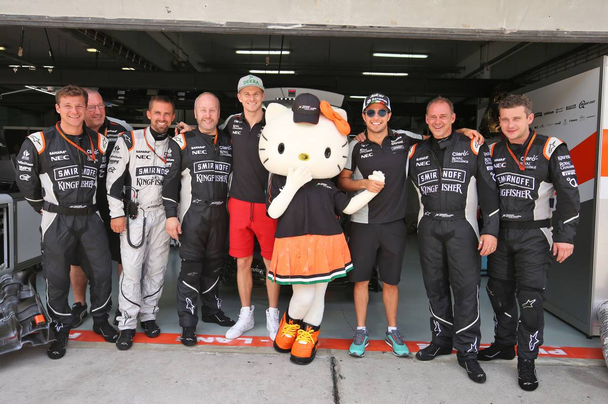 Nico Hulkenberg (GER) Sahara Force India F1 and Sergio Perez (MEX) Sahara Force India F1 with Hello Kitty and members of the team.