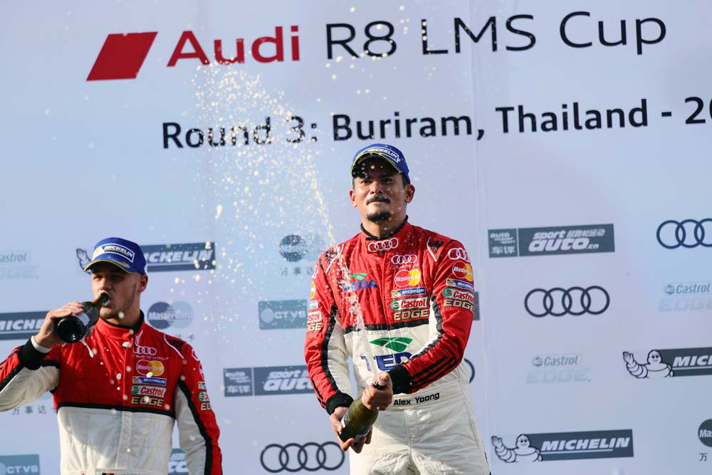 Alex Yoong (MAL) Audi TEDA Racing Team celebrates on the podium withthe champagne at Audi R8 LMS Cup, Rd3 and Rd4, Buriram International, Circuit, Buriram, Thailand, 22-24 July 2016.