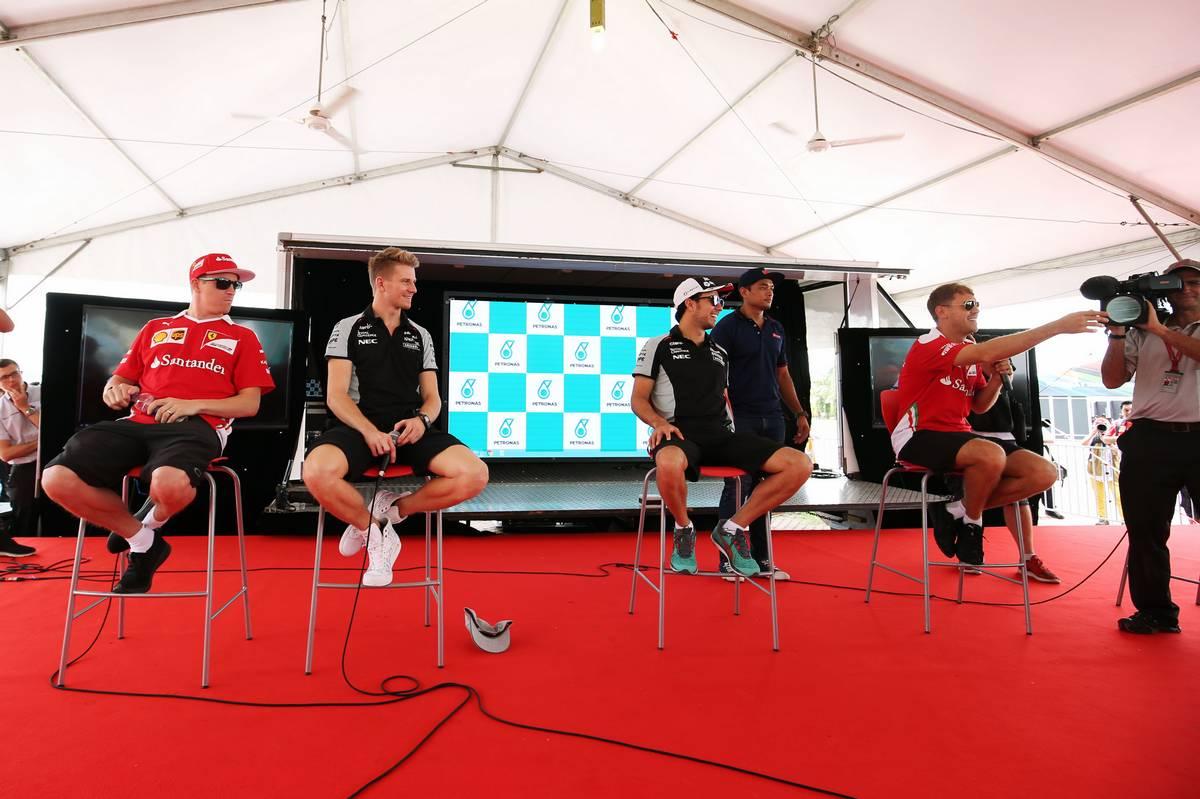 (L to R): Kimi Raikkonen (FIN) Ferrari with Nico Hulkenberg (GER) Sahara Force India F1; Sergio Perez (MEX) Sahara Force India F1; and Sebastian Vettel (GER) Ferrari.