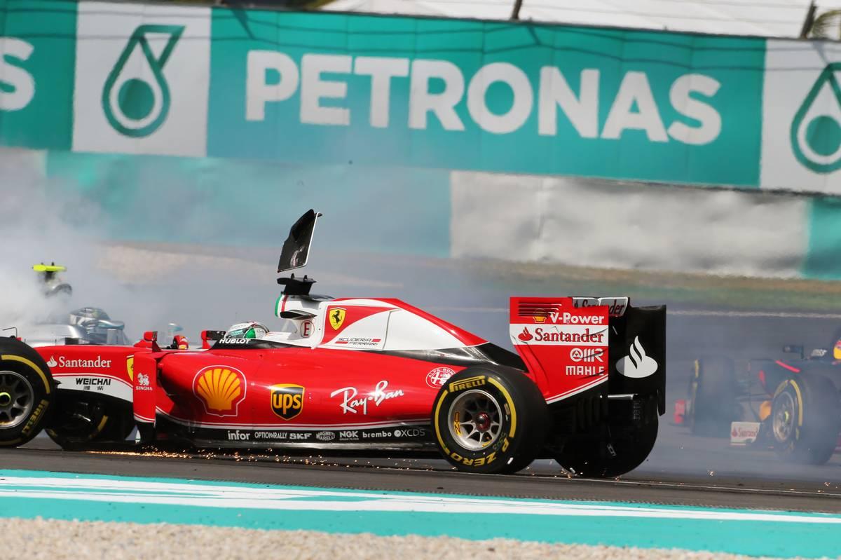 Sebastian Vettel (GER) Ferrari SF16-H and Nico Rosberg (GER) Mercedes AMG F1 W07 Hybrid collide at the start of the race.