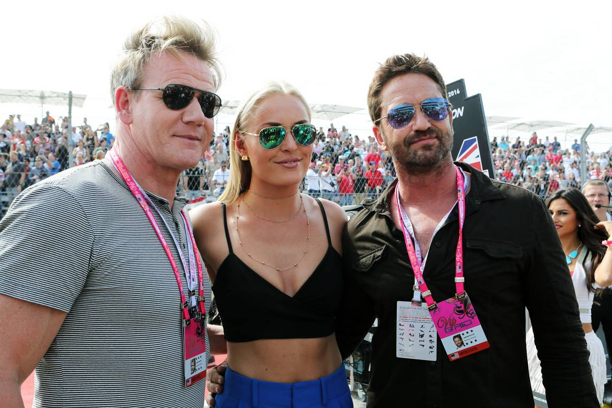 (L to R): Gordon Ramsey (GBR) Celebrity Chef with Lindsey Vonn (USA) Former Alpine Ski Racer and Gerard Butler (GBR) Actor on the grid.