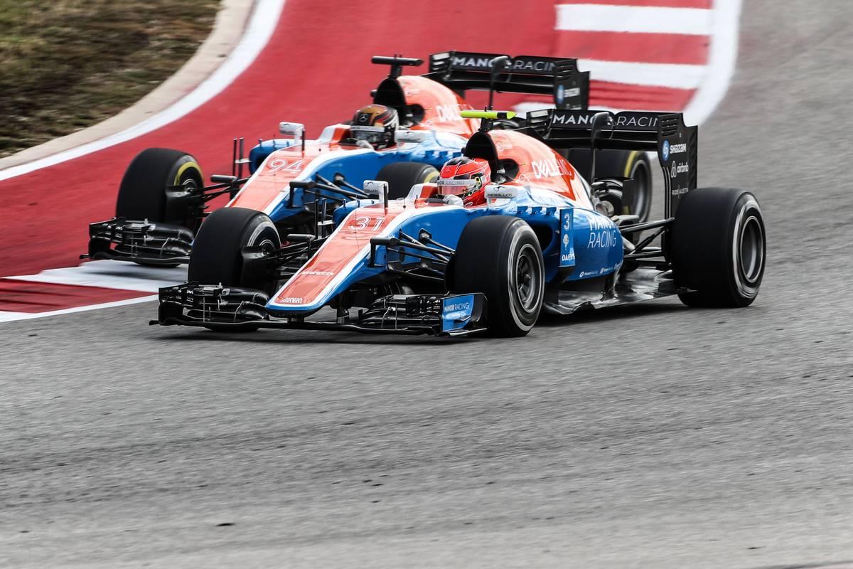 Esteban Ocon (FRA) Manor Racing MRT05 and team mate Pascal Wehrlein (GER) Manor Racing MRT05 battle for position.