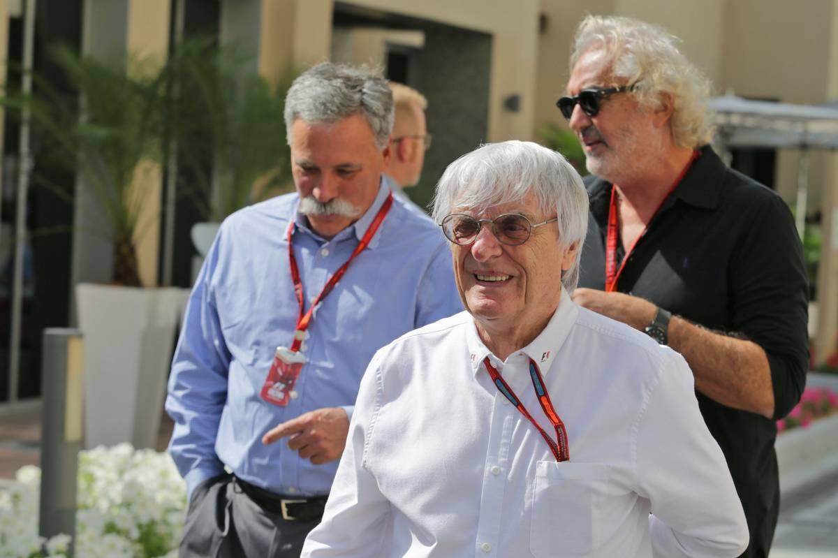 Bernie Ecclestone (GBR) with Chase Carey (USA) Formula One Group Chairman (Left) and Flavio Briatore (ITA) (Right).