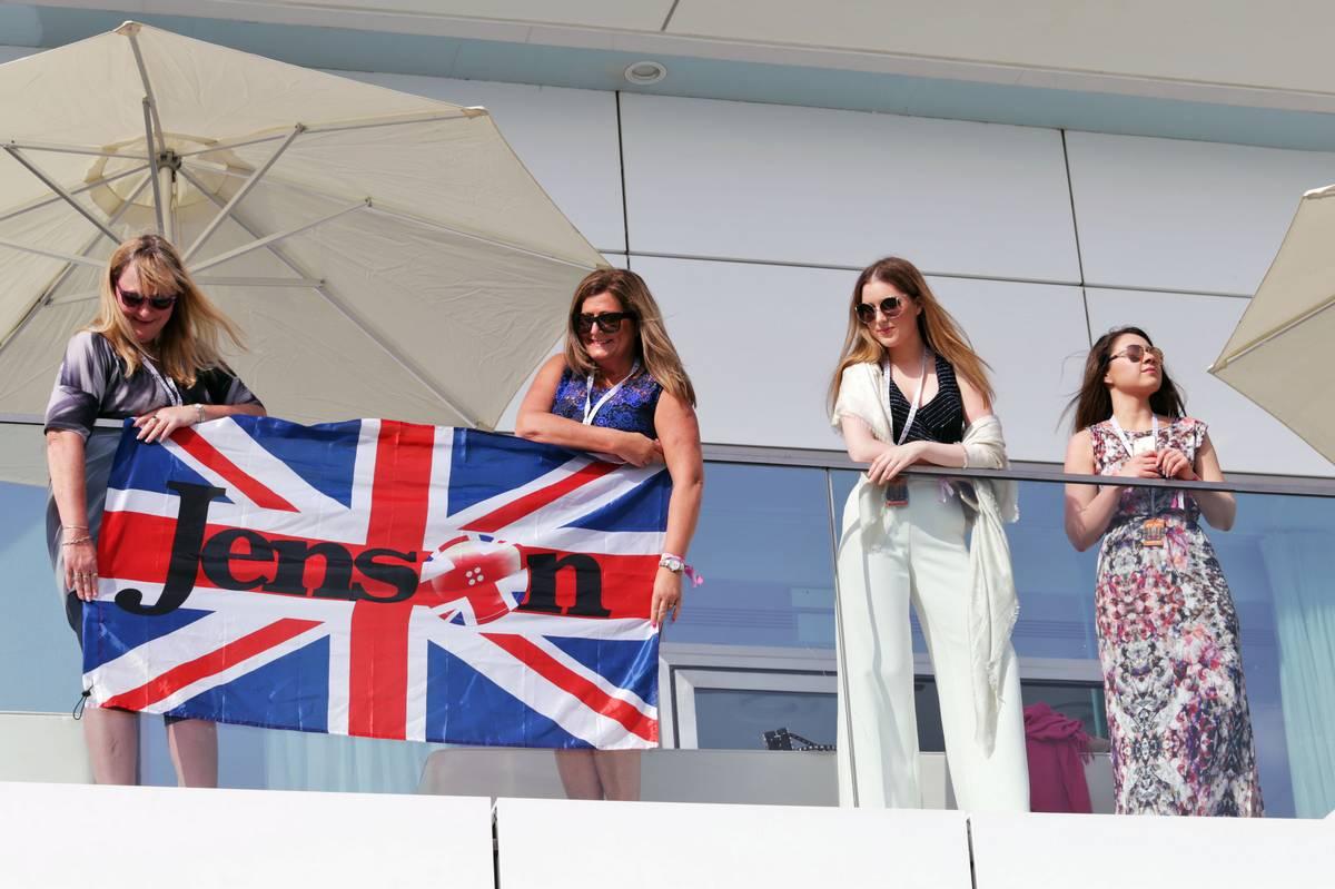 Jenson Button (GBR) McLaren flag and fans.